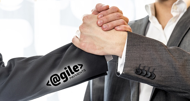 Close up of two businessmen in gray business suit gripping their hands in success and agreement at the office.