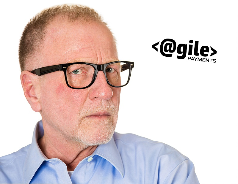 Closeup portrait, senior mature business man in black glasses, suspicious annoyed looking being cautious, careful, thinking, of his own mind, isolated white background. Emotion, facial expression