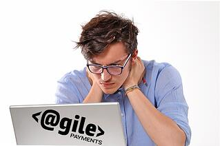 disheveled man looking at computer coming up with solutions for SaaS concerns